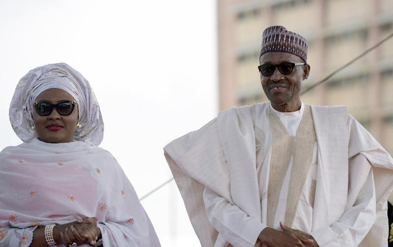 Nigerian President Mohammadu Buhari arrives with his wife Aisha, before taking oath of office at the Eagles Square in Abuja, on May 29, 2015 (AFP Photo/PIUS UTOMI EKPEI)
