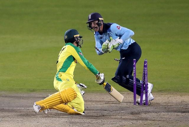 England's Jos Buttler stumps Australia's Alex Carey to seal a 24-run win and level the One-Day International series at 1-1. The decider is at Old Trafford on Wednesday