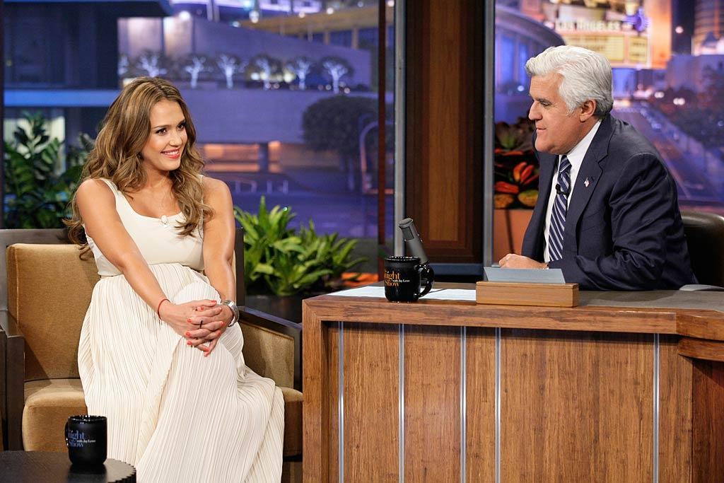 "An expectant Jessica Alba looked lovely in an ivory gown when she sat down with Jay Leno on ""The Tonight Show"" to chat about her upcoming ""Spy Kids"" sequel. The 30-year-old took advantage of her fellow guest, sex expert Dr. Sue Johanson, and asked if it's still OK to be, um, intimate at such a late stage of pregnancy. ""That baby is in there and that baby ain't going nowhere until it's ready,"" said the good doctor. Asked and answered! Paul Drinkwater/NBC - July 26, 2011"