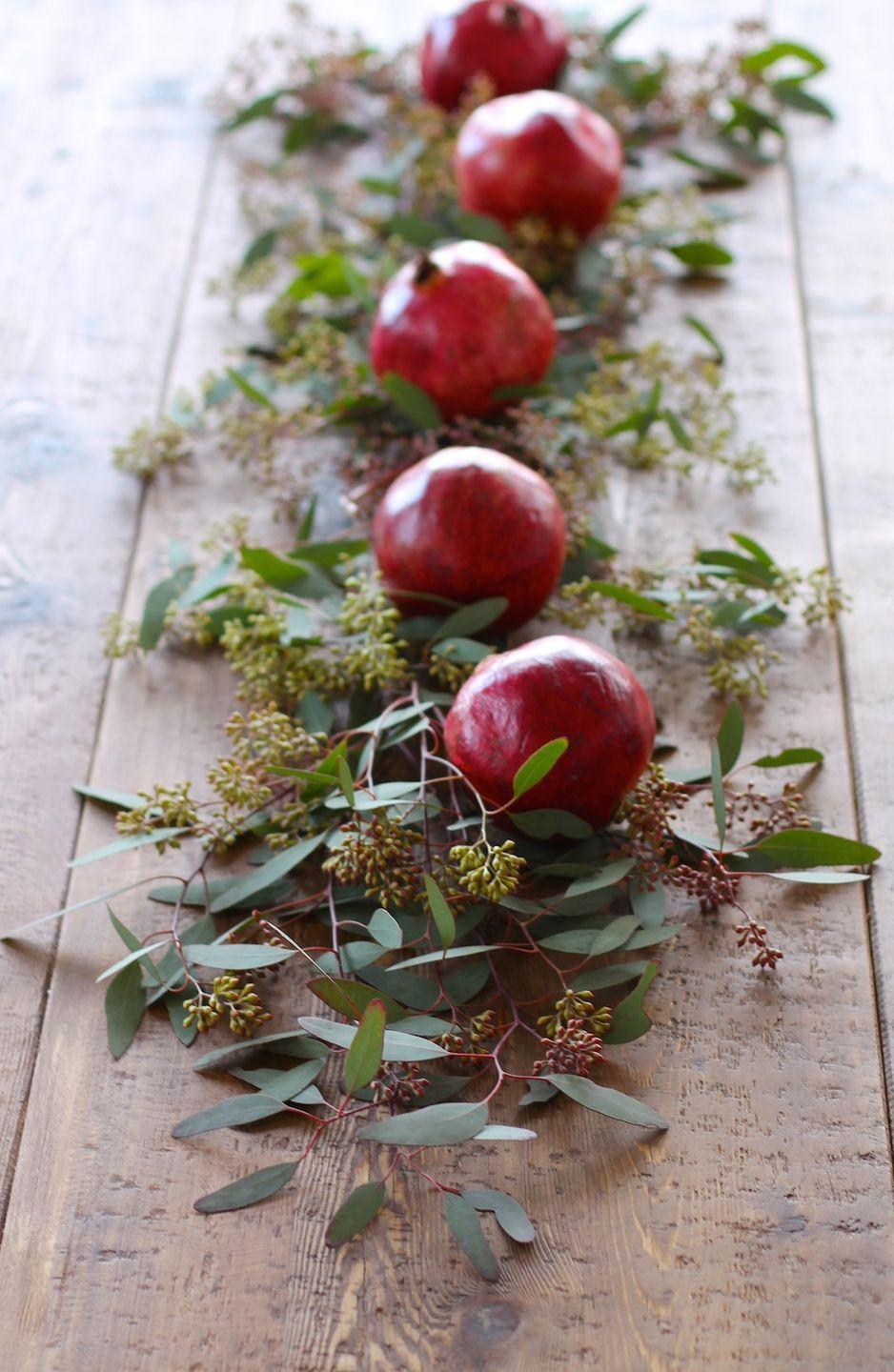 """<p>In ancient Greece, pomegranates were consumed on holy days. If the red fruit doesn't make it onto your Christmas menu, this table runner should keep the tradition alive.</p><p><a class=""""link rapid-noclick-resp"""" href=""""https://www.amazon.com/Gresorth-Lifelike-Artificial-Pomegranet-Decoration/dp/B0113Y4E3K?tag=syn-yahoo-20&ascsubtag=%5Bartid%7C10055.g.2196%5Bsrc%7Cyahoo-us"""" rel=""""nofollow noopener"""" target=""""_blank"""" data-ylk=""""slk:SHOP FAUX POMEGRANATES"""">SHOP FAUX POMEGRANATES</a></p><p><em><a href=""""http://julieblanner.com/5-minute-floral-christmas-table-runner/"""" rel=""""nofollow noopener"""" target=""""_blank"""" data-ylk=""""slk:Get the tutorial from Julie Blanner »"""" class=""""link rapid-noclick-resp"""">Get the tutorial from Julie Blanner »</a></em></p>"""
