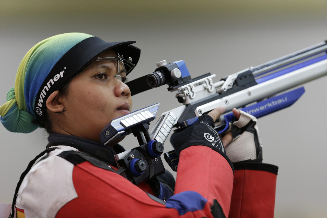 Malaysian shooting athlete Nur Suryani Mohamed Taibi, who is eight months pregnant, trains for the 10-meter air rifle event at the Royal Artillery Barracks, ahead of the the start of the 2012 Summer Olympics, Thursday, July 26, 2012, in London. (AP Photo/Rebecca Blackwell)