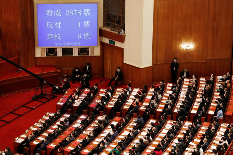 Screen shows the results of the vote on the national security legislation for Hong Kong Special Administrative Region at the closing session of NPC in Beijing