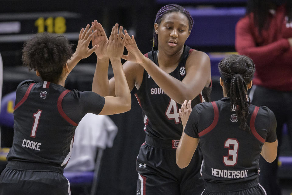 South Carolina forward Aliyah Boston (4) is introduced with teammates South Carolina guard Zia Cooke (1) and South Carolina guard Destanni Henderson (3) at an NCAA basketball game against LSU in Baton Rouge, La., Sunday, Jan. 24, 2021. (AP Photo/Matthew Hinton)