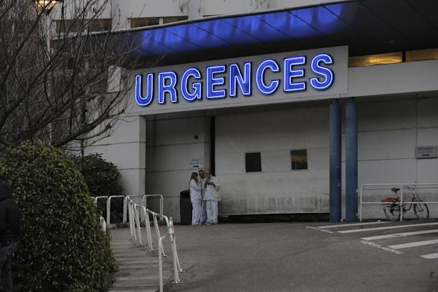 """Medical staff of the Grenoble hospital, in the French Alps, wait at the entrance of the emergency department where former seven-time Formula One champion Michael Schumacher is be treated after he sustained a head injury during a ski accident in Meribel, France Sunday, Dec. 29, 2013. The French Mountain Gendarmerie said Schumacher was wearing a helmet when he had a hard fall at Meribel and that he sustained a """"relatively serious"""" head injury. He was initially taken to a local hospital and later transferred to a hospital in the city of Grenoble. (AP Photo/Laurent Cipriani)"""