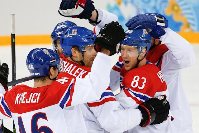 Czech Republic forward Ales Hemsky (83) celebrates his goal against Slovakia with his teammates during the first period of the 2014 Winter Olympics men's ice hockey game at Shayba Arena, Tuesday, Feb. 18, 2014, in Sochi, Russia. (AP Photo/Petr David Josek)