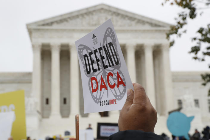 People rally outside the Supreme Court as oral arguments are heard in the case of President Trump's decision to end the Obama-era, Deferred Action for Childhood Arrivals program (DACA), at the Supreme Court in Washington in 2019. (Jacquelyn Martin/AP)