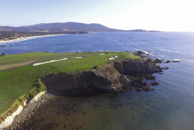 This Nov. 8, 2018 photo shows an aerial view of the sixth and seventh holes of the Pebble Beach Golf Links in Pebble Beach, Calif. The U.S. Open golf tournament is scheduled at Pebble Beach from June 13-16, 2019. (AP Photo/Terry Chea)