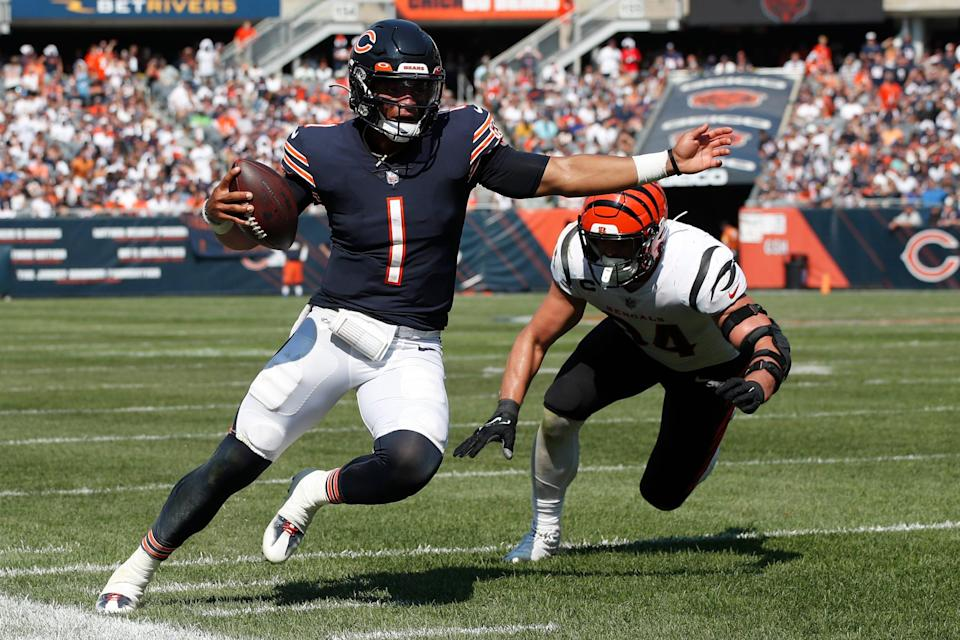 Chicago Bears quarterback Justin Fields (1) runs the ball against the Cincinnati Bengals during an NFL football game Sunday, Sept. 19, 2021, in Chicago.