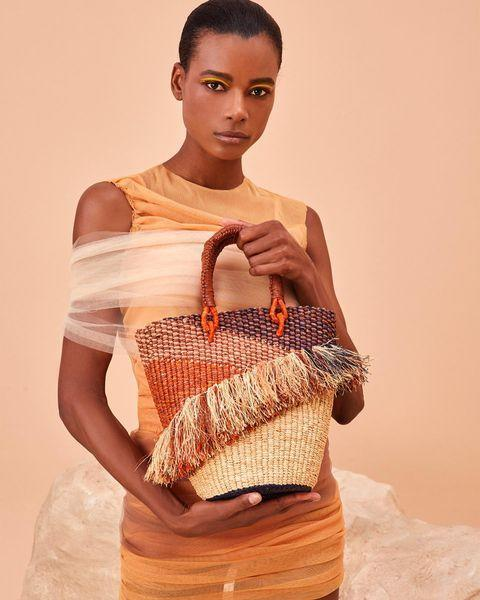 """<p>Who: Akosua Afriyie-Kumi</p><p>What: 'Handcrafted in Ghana, AAK S creates bags in styles that maintain the spirit and durability of their ancestral counterparts characterised by bright exuberant colours. '</p><p><a class=""""link rapid-noclick-resp"""" href=""""https://www.aaksonline.com/all"""" rel=""""nofollow noopener"""" target=""""_blank"""" data-ylk=""""slk:SHOP AAAKS NOW"""">SHOP AAAKS NOW</a></p><p><a href=""""https://www.instagram.com/p/B8yb_rilObU/"""" rel=""""nofollow noopener"""" target=""""_blank"""" data-ylk=""""slk:See the original post on Instagram"""" class=""""link rapid-noclick-resp"""">See the original post on Instagram</a></p>"""