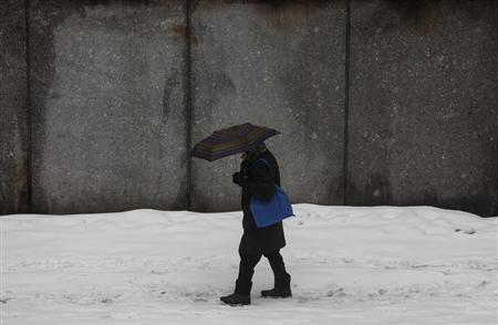 A man walks through the snow in New York