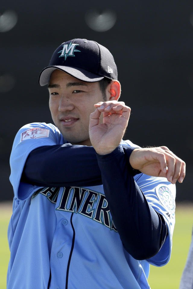 Seattle Mariners pitcher Yusei Kikuchi, from Japan, stretches during spring training baseball practice, Tuesday, Feb. 12, 2019, in Peoria, Ariz. (AP Photo/Charlie Riedel)