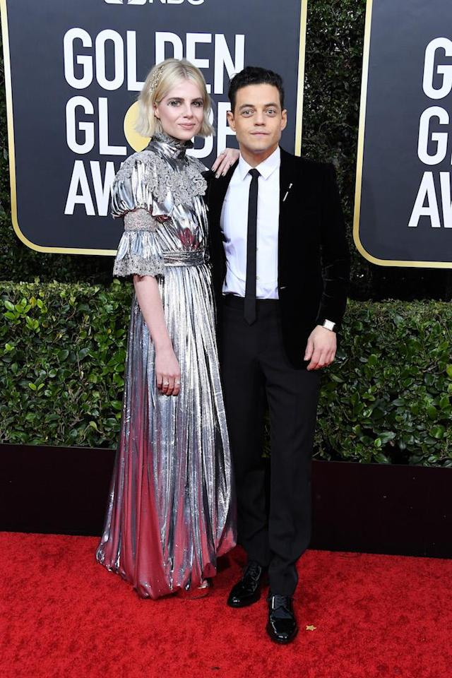 Lucy Boynton is wearing Louis Vuitton finished with Harry Winston Jewels while Rami Malek is in Saint Laurent. <em>[Photo: Getty]</em>