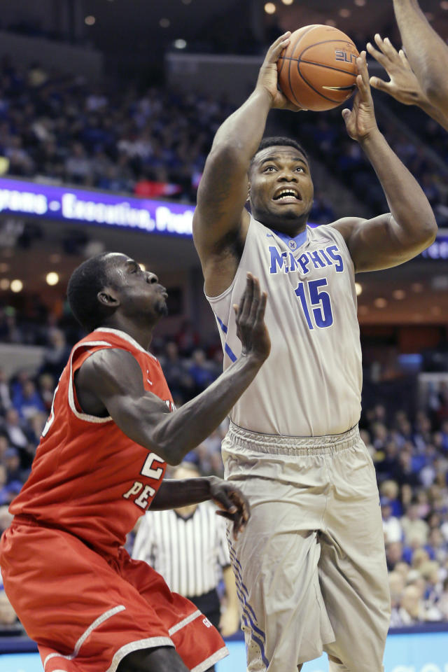 Memphis' Dominic Woodson (15) shoots in front of Austin Peay's Serigne Mboup, of Senegal, left, in the first half of an NCAA college basketball game in Memphis, Tenn., Thursday, Nov. 14, 2013. (AP Photo/Danny Johnston)