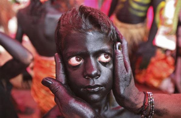 Nine-year-old Rahul gets his make-up done to look like a demon before the start of a religious procession ahead of the Mahashivratri festival in Jammu February 18, 2012. Hindu women across the country celebrate Mahashivratri, better known as Lord Shiva's wedding anniversary, so that their husbands will be blessed with long lives.