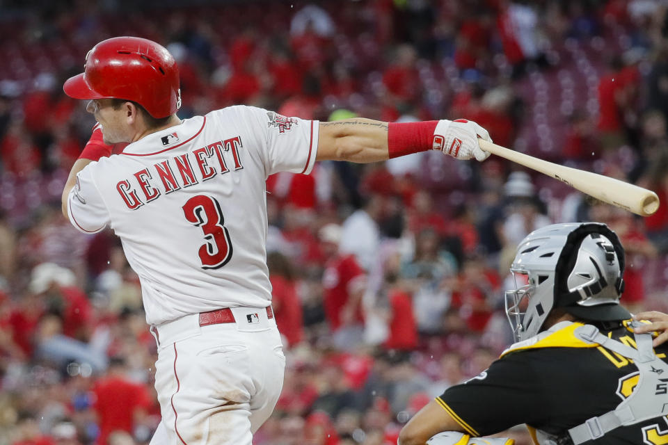 Cincinnati Reds' Scooter Gennett hits an RBI-double off Pittsburgh Pirates starting pitcher Alex McRae in the second inning of a baseball game, Monday, July 29, 2019, in Cincinnati. (AP Photo/John Minchillo)