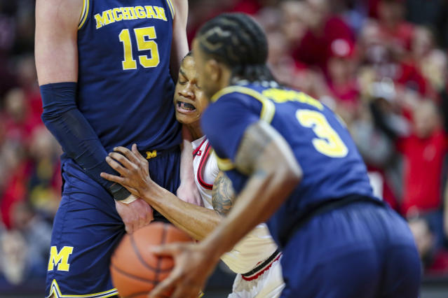 Rutgers guard Jacob Young (42) runs into a pick set by Michigan center Jon Teske (15) as guard Zavier Simpson (3) moves the ball during the first half of an NCAA college basketball game, Wednesday, Feb. 19, 2020 in Piscataway, N.J. (Andrew Mills/NJ Advance Media via AP)
