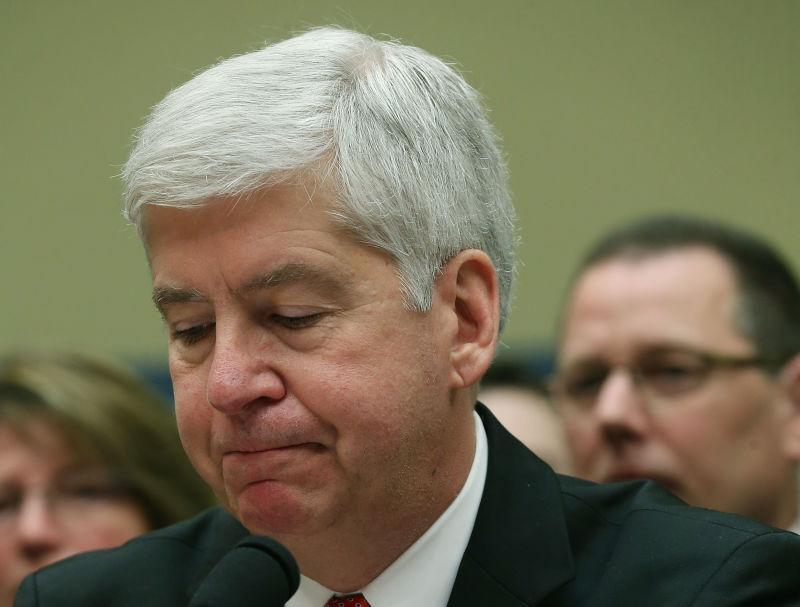 Gov. Rick Snyder, (R-MI), listens to members comments during a House Oversight and Government Reform Committee hearing, about the Flint, Michigan water crisis, on Capitol Hill