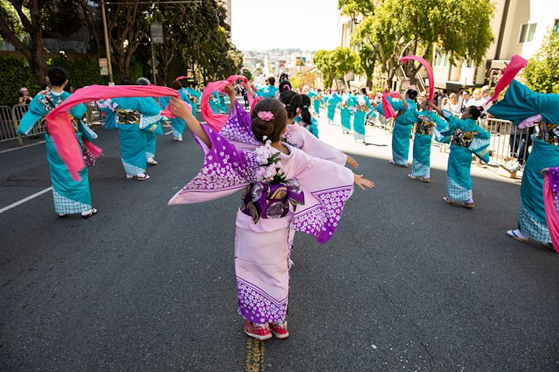 Participants in the 2019 Northern California Cherry Blossom Festival march through Japantown.
