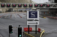 The ferry terminal check-in is empty whilst the Port remains closed, in Dover, the main ferry link between southern England and France, Tuesday, Dec. 22, 2020. Trucks waiting to get out of Britain backed up for miles and people are left stranded at airports as dozens of countries around the world slapped tough travel restrictions on the U.K. because of a new and seemingly more contagious strain of the coronavirus in England.(AP Photo/Kirsty Wigglesworth)