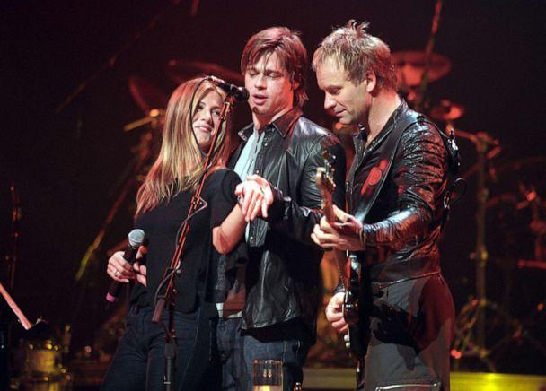 PHOTO: Jennifer Aniston and Brad Pitt show off Jennifer's engagement ring onstage at the Beacon Theater in New York during a Sting concert on Nov. 21, 1999. (K. Mazur/WireImage via Getty Images, FILE)