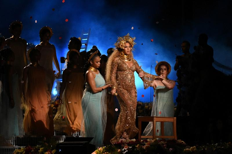 Beyonce's Grammys performance returned to the theme of matriarchy as she donned a crown and her female troupe glided beneath her on a sea of flowers (AFP Photo/VALERIE MACON                       )