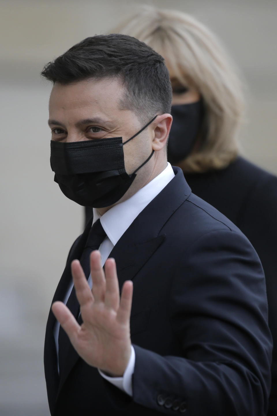 Ukrainian President Volodymyr Zelenskyy gestures as he arrives at the Elysee palace in Paris, Friday, April 16, 2021. Ukrainian President Volodymyr Zelenskyy is holding talks with French President Emmanuel Macron and German Chancellor Angela Merkel amid growing tensions with Russia, which has deployed troops at the border with the country. (AP Photo/Lewis Joly)