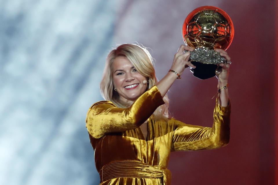 FILE - In this Dec. 3, 2018, file photo, Olympique Lyonnais soccer player Ada Hegerberg celebrates with the Women's Ballon d'Or award during the Golden Ball award ceremony at the Grand Palais in Paris, France. The world's best player won't be at the Women's World Cup. Hegerberg stepped away in 2017 because of what she perceives to be a general disregard for women's soccer by the country's federation. (AP Photo/Christophe Ena, File)