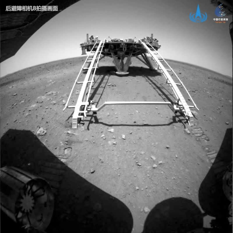 Handout image of Chinese rover Zhurong of the Tianwen-1 mission driving down the ramp of the lander onto the surface of Mars