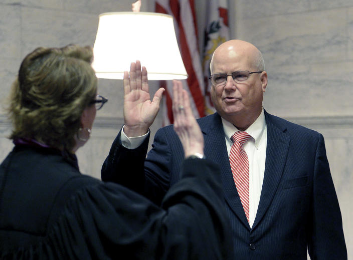 West Virginia Circuit Judge Paul T. Farrell is sworn in as a Supreme Court Justice by Justice Robin Davis in the Supreme Court Chamber in Charleston, W.Va. Friday Aug. 10, 2018. Chief Justice Margaret Workman announced Farrell's appointment in a statement Thursday and signed an order saying Farrell will be assigned as the acting chief justice if impeachment proceedings against the current justices go to trial in the state Senate. (Chris Dorst/Charleston Gazette-Mail via AP)