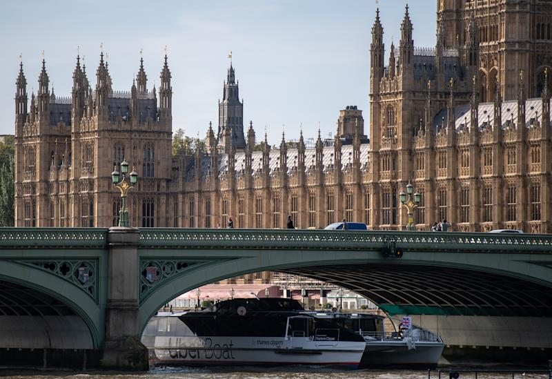 LONDON, ENGLAND - SEPTEMBER 28: An Uber boat pases the Houses to Parliament on the River Thames on September 28, 2020 in London, England. The ride-sharing service won its appeal after Transport for London denied a renewal of its operating license late last year. (Photo by Chris J Ratcliffe/Getty Images)