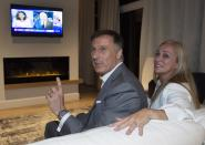 People's Party of Canada Leader Maxime Bernier and his wife Catherine Letarte watches elections results on television Monday, October 21, 2019 in Beauceville, Que. Canadians are going to the polls in a general election. THE CANADIAN PRESS/Jacques Boissinot
