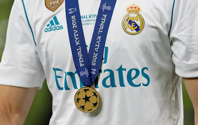 Soccer Football - Champions League Final - Real Madrid v Liverpool - NSC Olympic Stadium, Kiev, Ukraine - May 26, 2018 General view of Real Madrid's Nacho wearing his Champions League winners medal REUTERS/Andrew Boyers