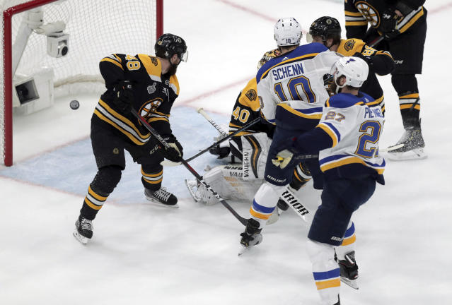 St. Louis Blues' Alex Pietrangelo, right, watches his shot sail into the net behind Boston Bruins goaltender Tuukka Rask (40), of Finland, and Matt Grzelcyk (48) during the first period in Game 7 of the NHL hockey Stanley Cup Final, Wednesday, June 12, 2019, in Boston. (AP Photo/Charles Krupa)