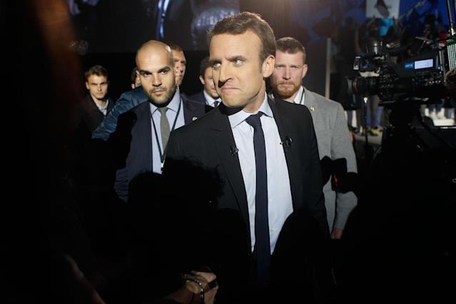 <p>French independent centrist presidential candidate Emmanuel Macron arrives for an election campaign rally in Arras, northern France, Wednesday, April 26, 2017. Battling for France's blue-collar vote and employing all of her political guile, far-right presidential candidate Marine Le Pen upstaged her centrist rival Macron by making a surprise campaign stop Wednesday to a home appliance factory threatened with closure. (AP Photo/Thibault Camus) </p>