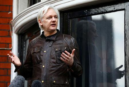 FILE PHOTO - WikiLeaks founder Julian Assange is seen on the balcony of the Ecuadorian Embassy in London, Britain