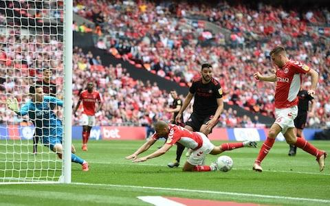 Ben Purrington of Charlton Athletic scores his team's first goal during the Sky Bet League One Play-off Final match between Charlton Athletic and Sunderland at Wembley Stadium - Credit: Harriet Lander/Copa/Getty Images