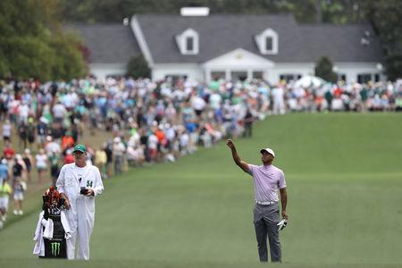 Golf - Masters - Augusta National Golf Club - Augusta, Georgia, U.S. - April 13, 2019 - Tiger Woods of the U.S. checks the wind before making his second shot on the 1st hole during third round play. REUTERS/Lucy Nicholson