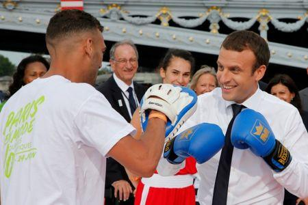 French President Emmanuel Macron (R) spars with a boxer in Paris, France, June 24, 2017. REUTERS/Jean-Paul Pelissier