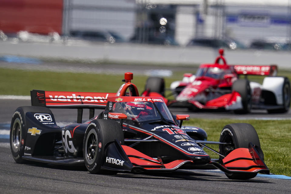 Will Power of Australia drives through a turn during practice for the IndyCar auto race at Indianapolis Motor Speedway in Indianapolis, Friday, May 14, 2021. (AP Photo/Michael Conroy)