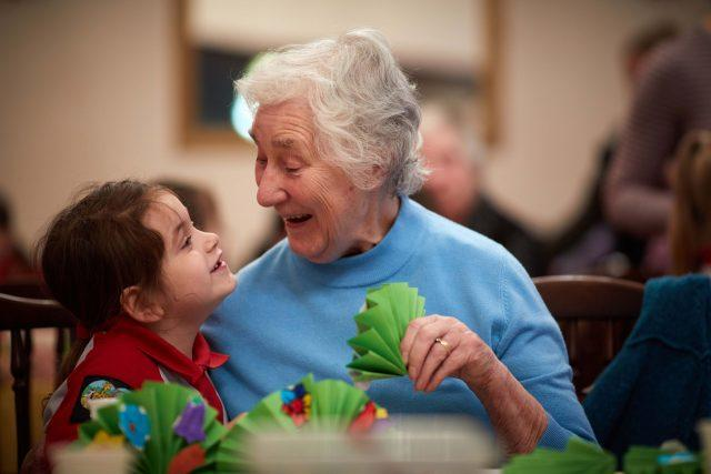 Nancy Cox, six, from 1st Northenden (St Wilfrid's) Rainbows, with 82-year-old Jean Feltham