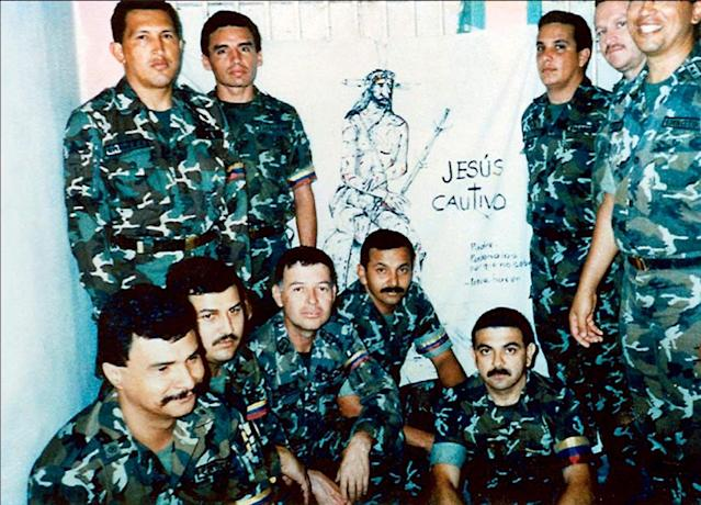 In this photo released by Miraflores Press Office, Hugo Chavez, top left, poses with fellow members of the failed coup as they serve time in Yare II jail near Caracas, Venezuela. Venezuela's Vice President Nicolas Maduro announced on Tuesday, March 5, 2013 that Chavez has died. Chavez, 58, was first diagnosed with cancer in June 2011. (AP Photo/Miraflores Press Office)