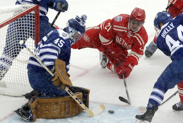 Toronto Maple Leafs goalie Jonathan Bernier (45) blocks a shot by Detroit Red Wings left wing Tomas Tatar (21), of the Czech Republic, during the first period of the Winter Classic outdoor NHL hockey game at Michigan Stadium in Ann Arbor, Mich., Wednesday, Jan. 1, 2014. (AP Photo/Carlos Osorio)