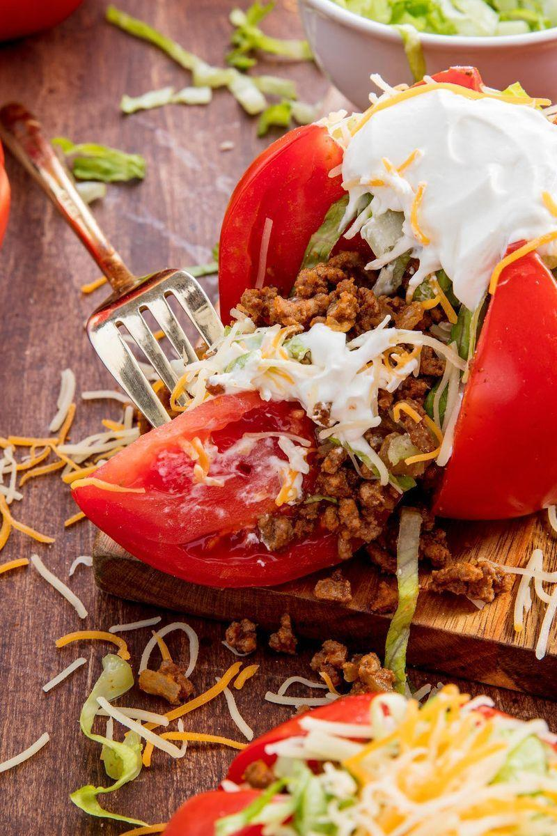 """<p>We're all for a genius low-carb hack — and these tomatoes totally deliver. We had never thought to stuff them with taco meat, cheese, and sour cream, but we'll do anything in the name of ditching a tortilla for a low-carb meal. </p><p>Get the <a href=""""https://www.delish.com/uk/cooking/recipes/a30053026/taco-tomatoes-recipe/"""" rel=""""nofollow noopener"""" target=""""_blank"""" data-ylk=""""slk:Taco Tomatoes"""" class=""""link rapid-noclick-resp"""">Taco Tomatoes</a> recipe.</p>"""
