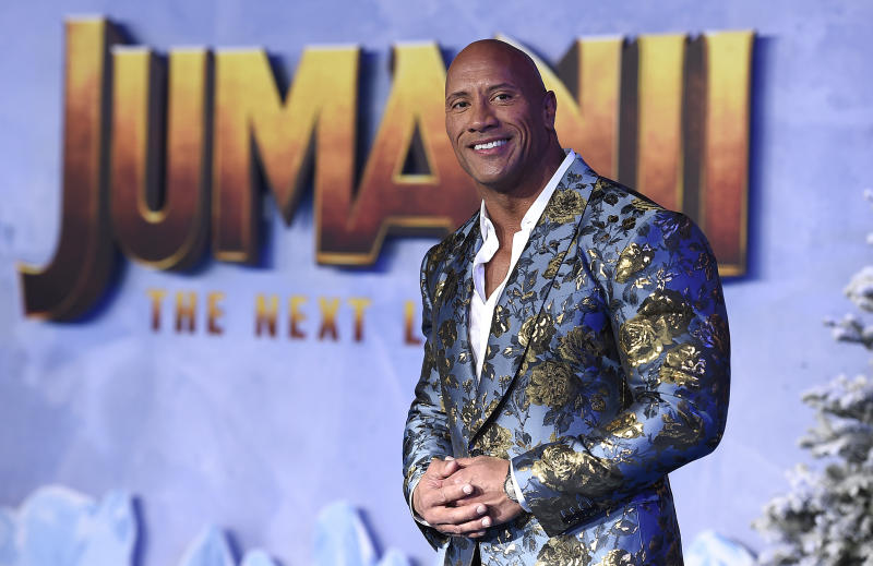 "Cast member Dwayne Johnson poses for photographers at the Los Angeles premiere of ""Jumanji: The Next Level"" at the TCL Chinese Theatre on Monday, Dec. 9, 2019. (Photo by Jordan Strauss/Invision/AP)"