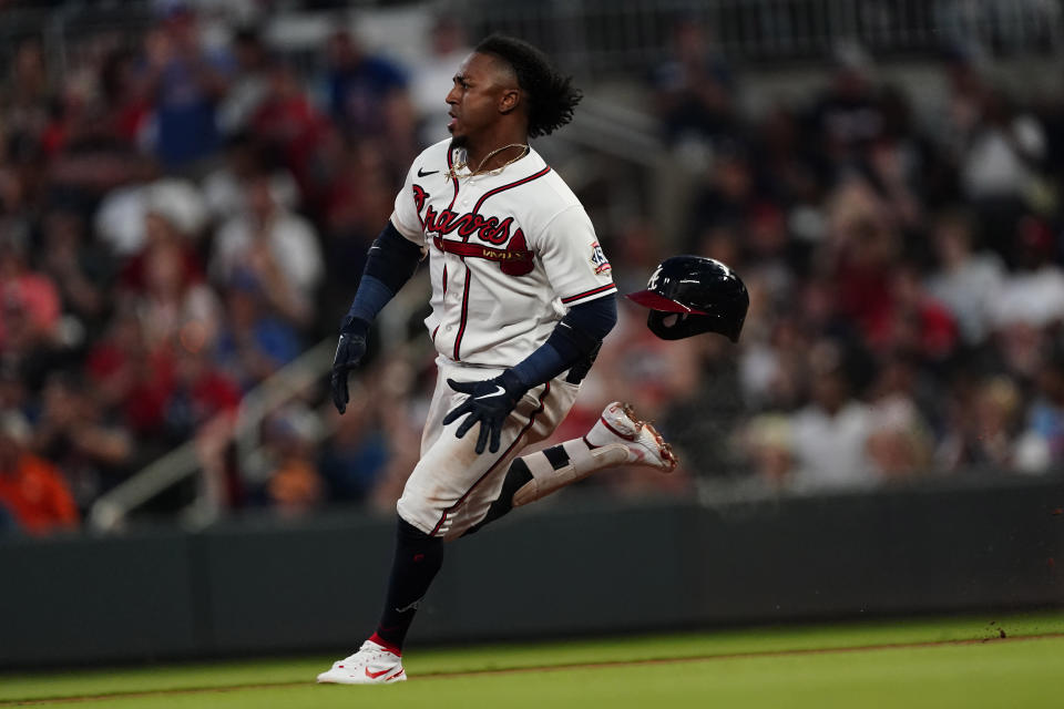 Atlanta Braves' Ozzie Albies runs to third base wafter hitting an RBI-triple in the sixth inning of a baseball game against the St. Louis Cardinals, Thursday, June 17, 2021, in Atlanta. (AP Photo/John Bazemore)