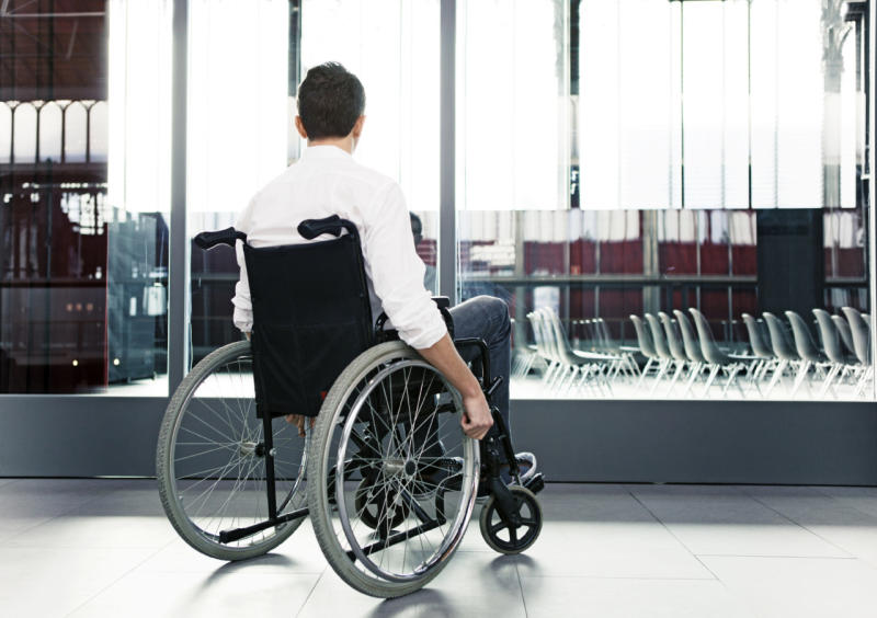 man in wheelchair forced to crawl off plane