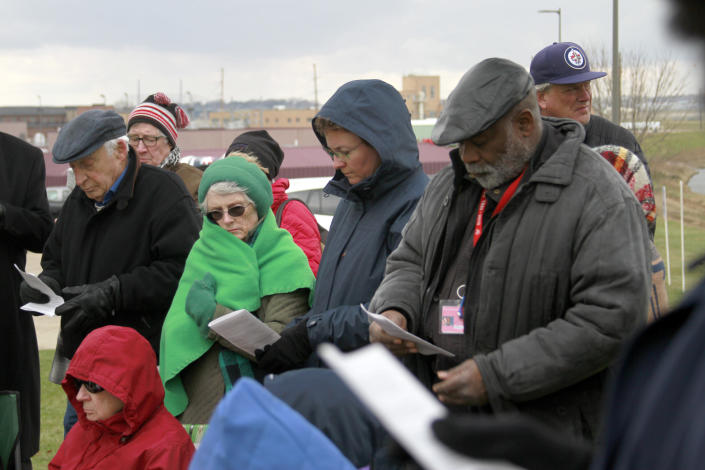 Protesters pray and sing outside the South Dakota State Penitentiary in Sioux Falls, Monday, Nov. 3, 2019, where Charles Russell Rhines is scheduled to die Monday, by lethal injection for the death of a former co-worker. Officials are waiting to hear from the United States Supreme Court on three appeals filed by Rhines. The state attorney general's office said it will not proceed with the execution until the Supreme Court rules on the matter. (AP Photo/Stephen Groves)