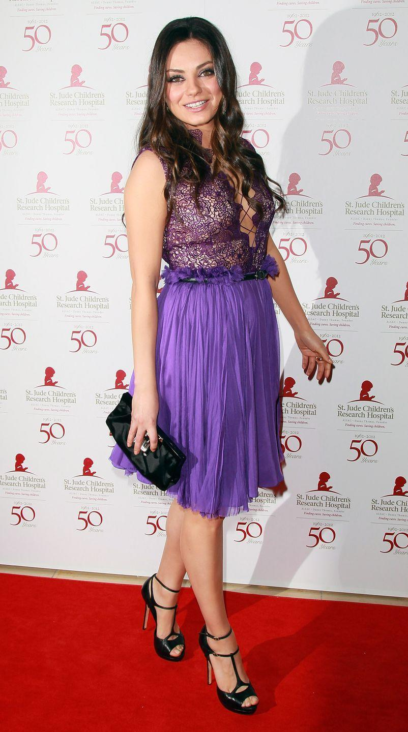 <p>Mila Kunis looked like Rapunzel all dressed up for a night on the town in this purple lace-up dress she wore in 2012.</p>