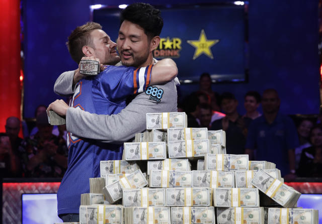 Tony Miles, left, embraces first place finisher John Cynn after the World Series of Poker main event in Las Vegas. (AP Photo)