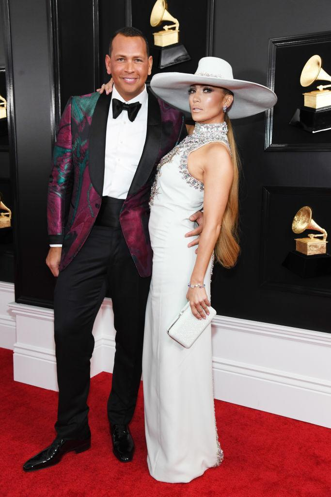 <p>Jennifer Lopez was workin' it in a Ralph & Russo gown with a high bejeweled neck and a matching hat. Her partner, Alex Rodriguez, was by her side in a tux with a colorful jacket. </p>